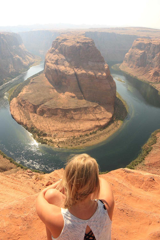 a girl overlooking horseshoe bend
