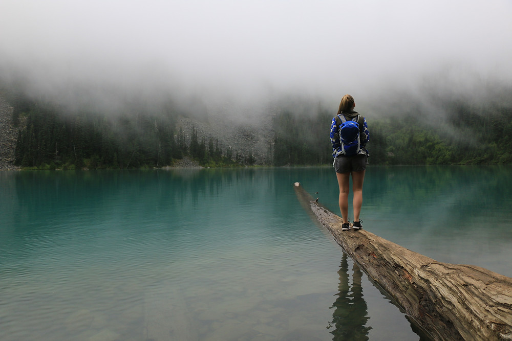 Girl standing on log at Middle Joffre Lake