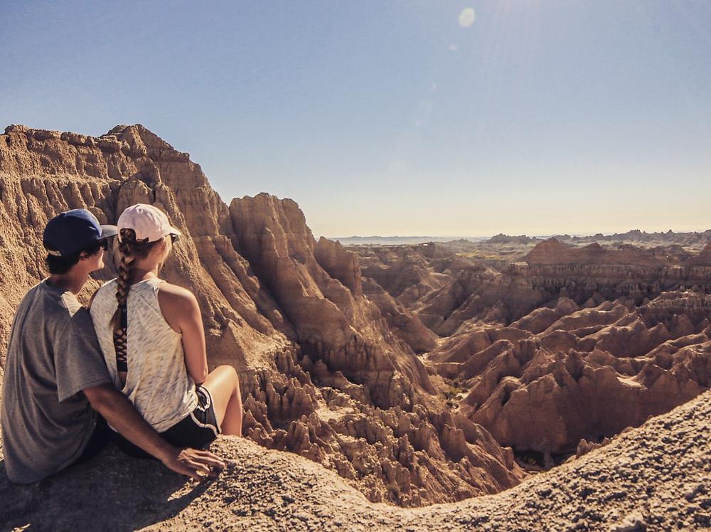 People looking over Badlands National Park