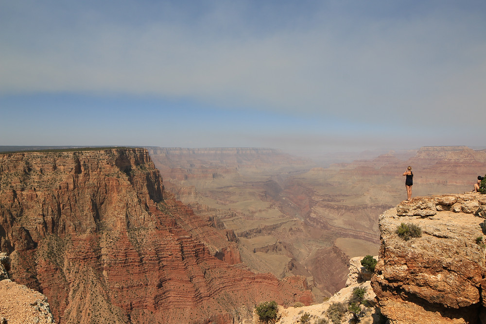 A girl looking over the grand canyon