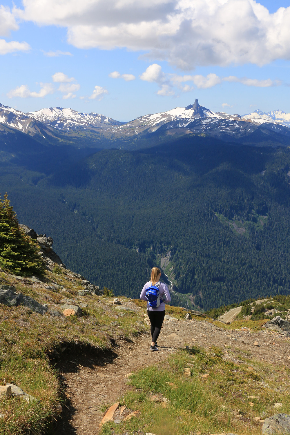 Girl hiking high note trail in whistler with black tusk in background