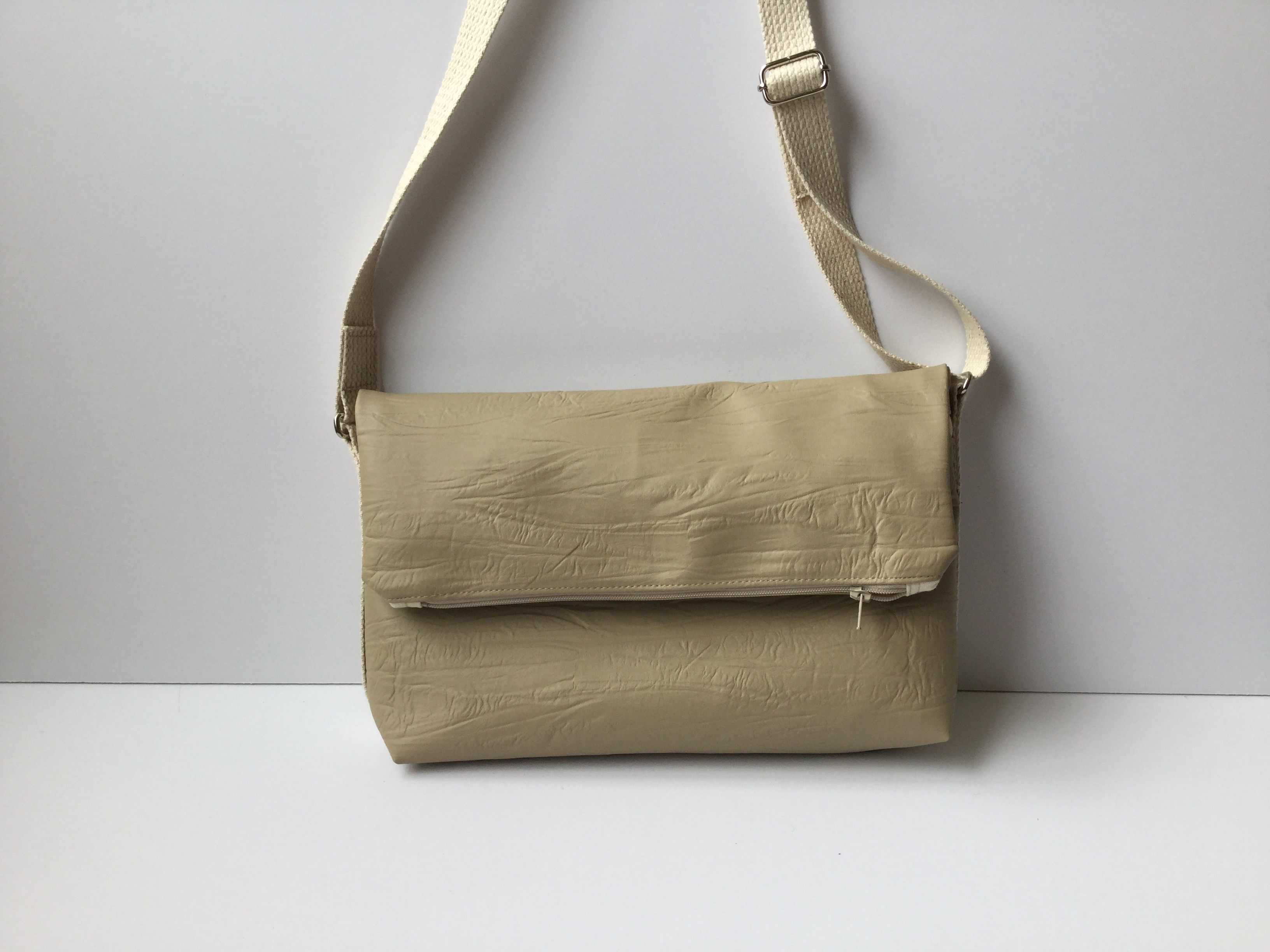 Neutral crossbody fold over