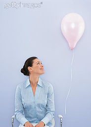 businesswoman%20looking%20at%20balloon%2
