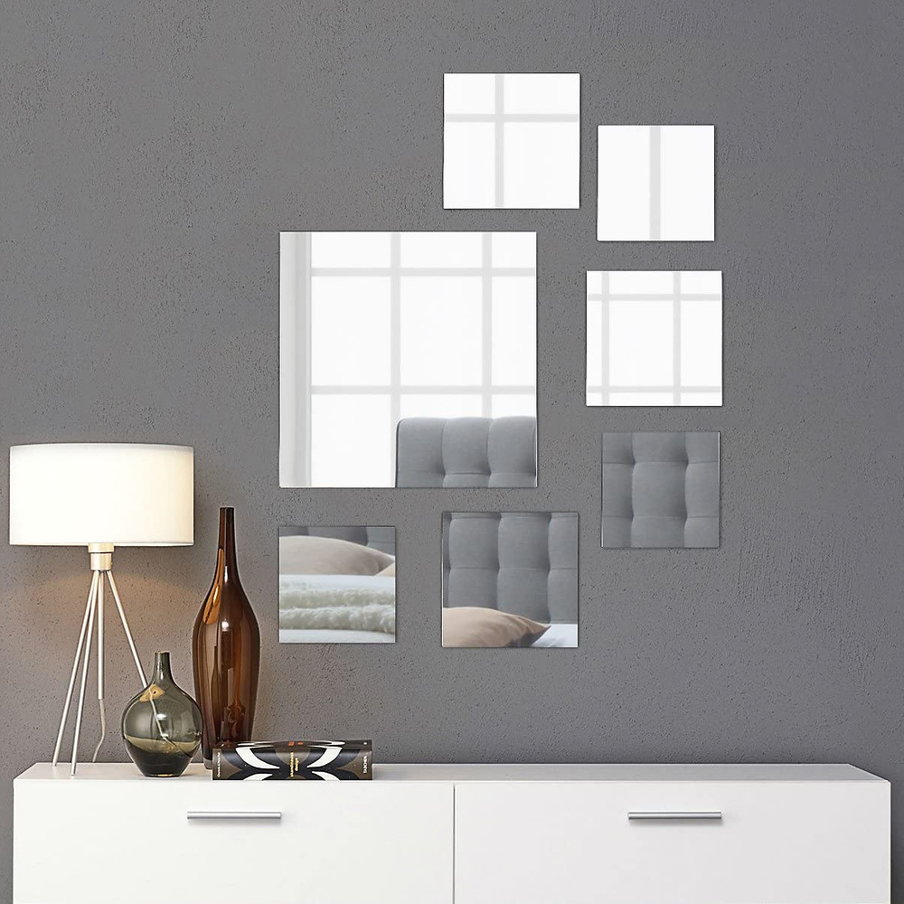 Different sizes of square shaped mirror to create harmony in the room