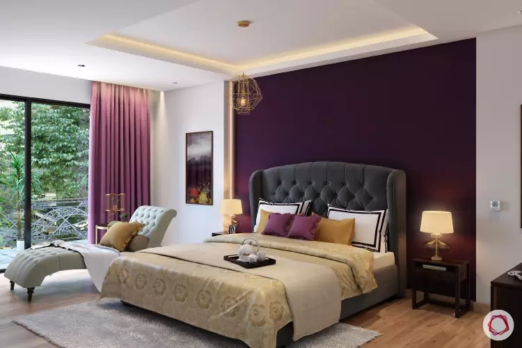 Purple color behind the bed headboard pop-ups the rest of the bedroom painted crisp white
