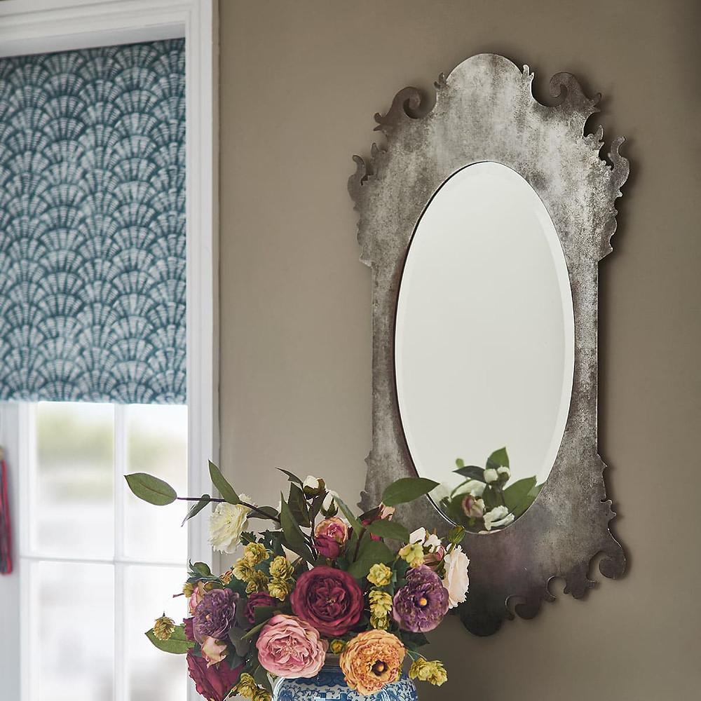 Beveled edge mirror in bedroom