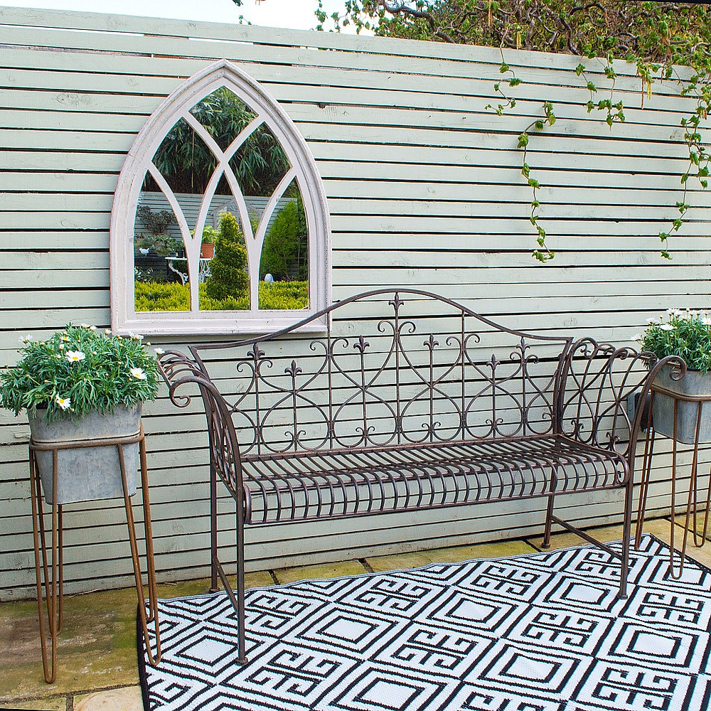 Outdoor sitting space enhanced with mirror