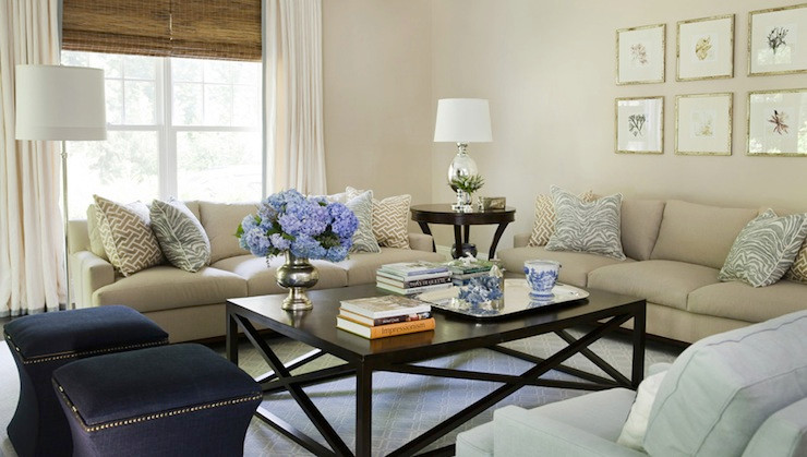 A timeless living space having a bland neutral color palette