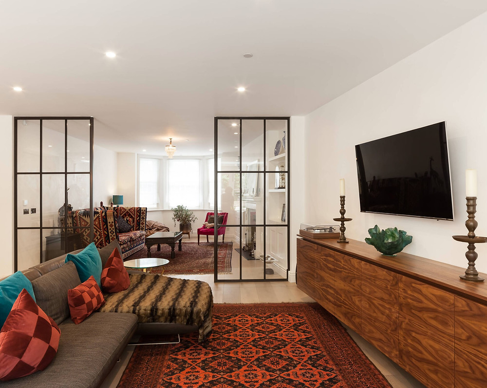Persian Rug of matching color and pattern in open floor plan