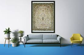 A well-defined border handwoven vintage rug hung as an art piece on the wall