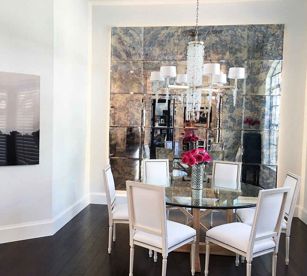 Antique mirror wall behind dining