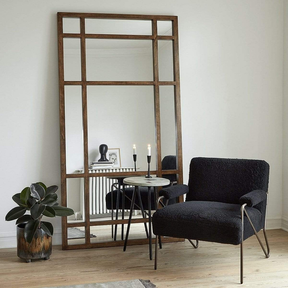 Statement mirror on the accent wall