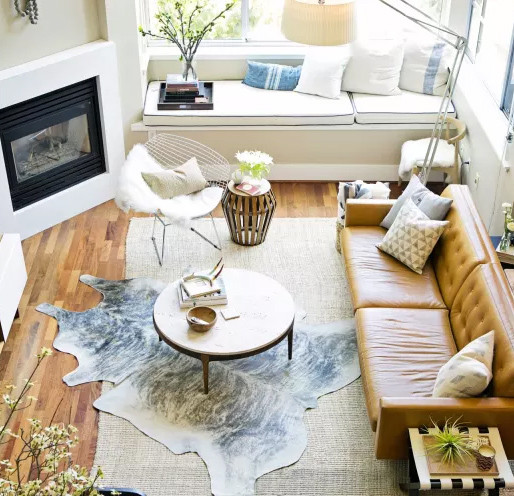 One rug layered with the other to create a room statement