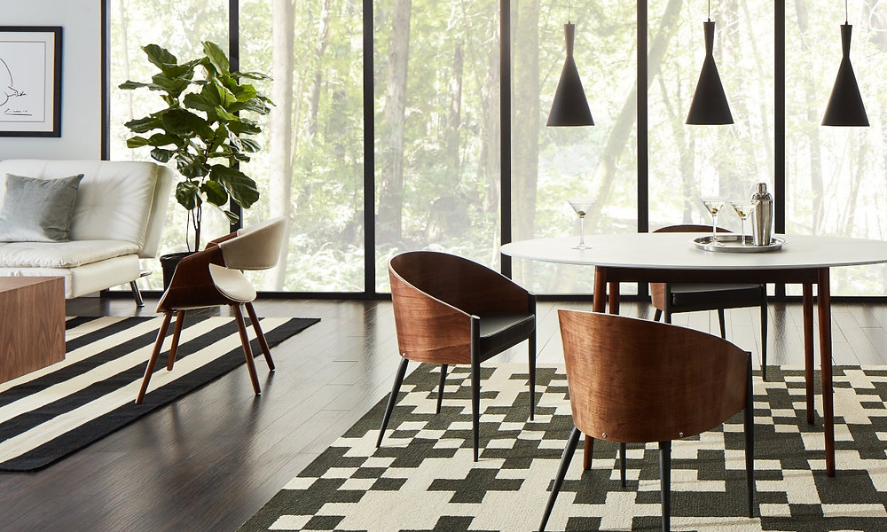 Different patterns of rugs in open floor plan