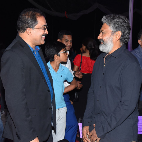 Dr. Satish and Rajamouli sharing pleasantaries