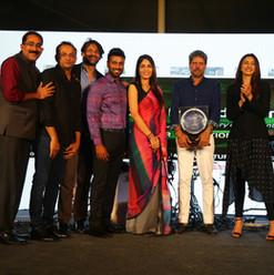 From left: Dr. Satish Ghanta, Mr. Shobu Yarlagadda, Mr. Rishi Raj Singh, Mr. Sanjay Gaddipati, Ms. Madhavi Chalasani, Mr. Kapil Dev and Ms. Rakul Preet Singh
