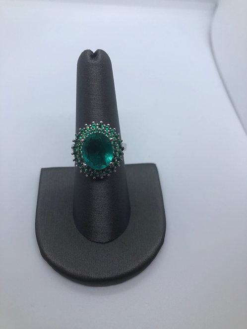 Emerald colour halo ring