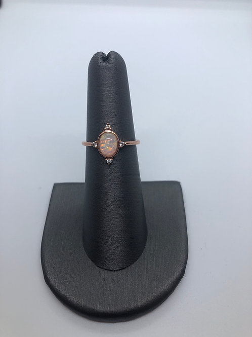Rose gold lab created opal ring