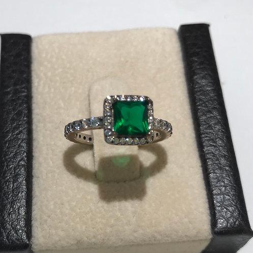 Square emerald on silver stone band