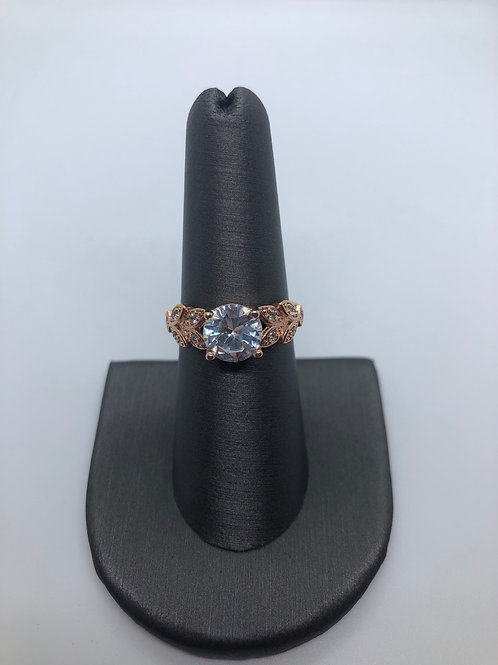 Solitaire leaf ring