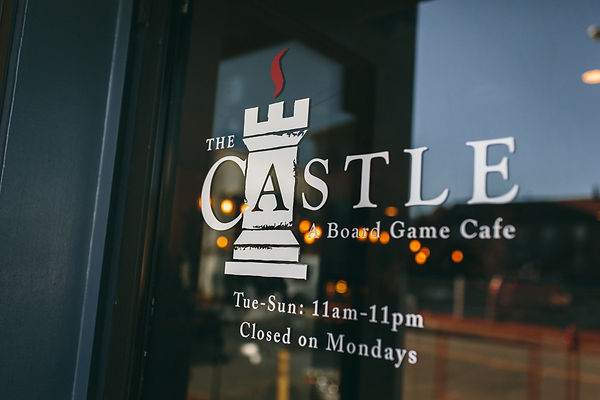 The Castle Cafe's old sticker deco logo that says closed monday, now updated to open all 7 days of the week!