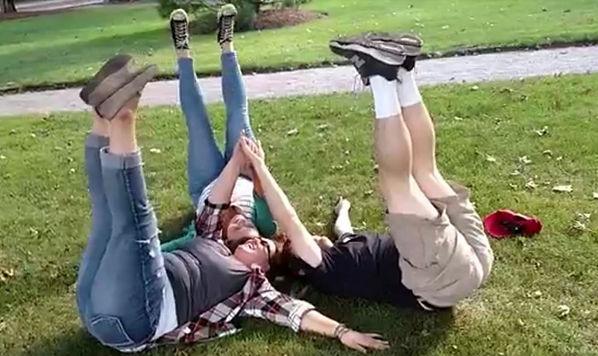 People having fun in the grass