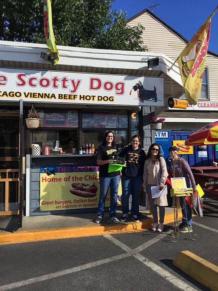 Standing outside theScotty Dog local shop