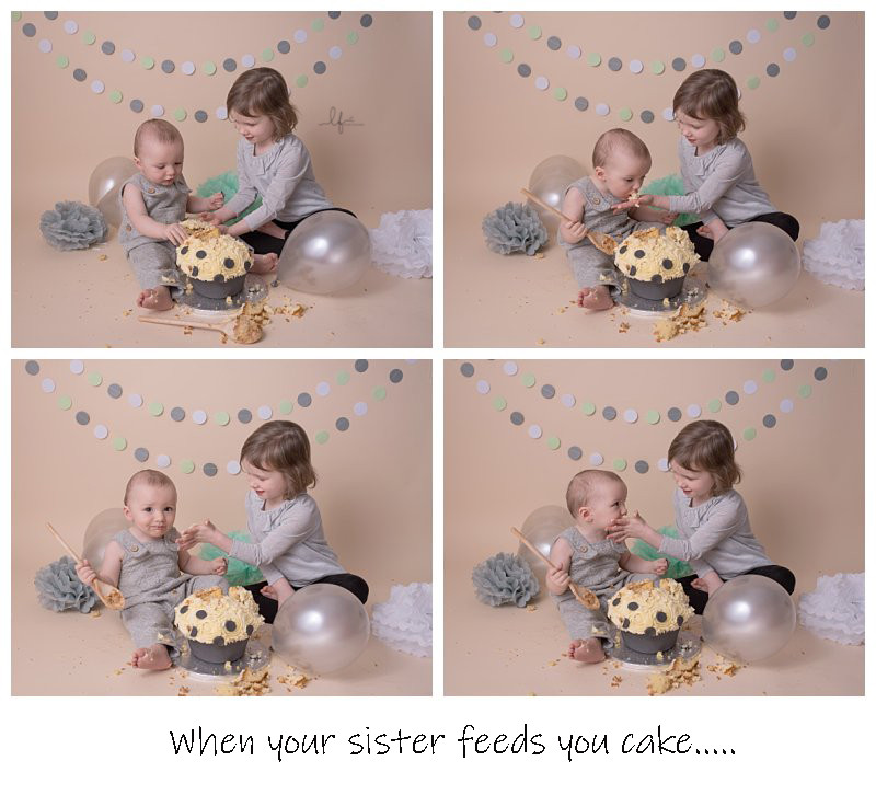 big sister helping her little brother with his cake smash