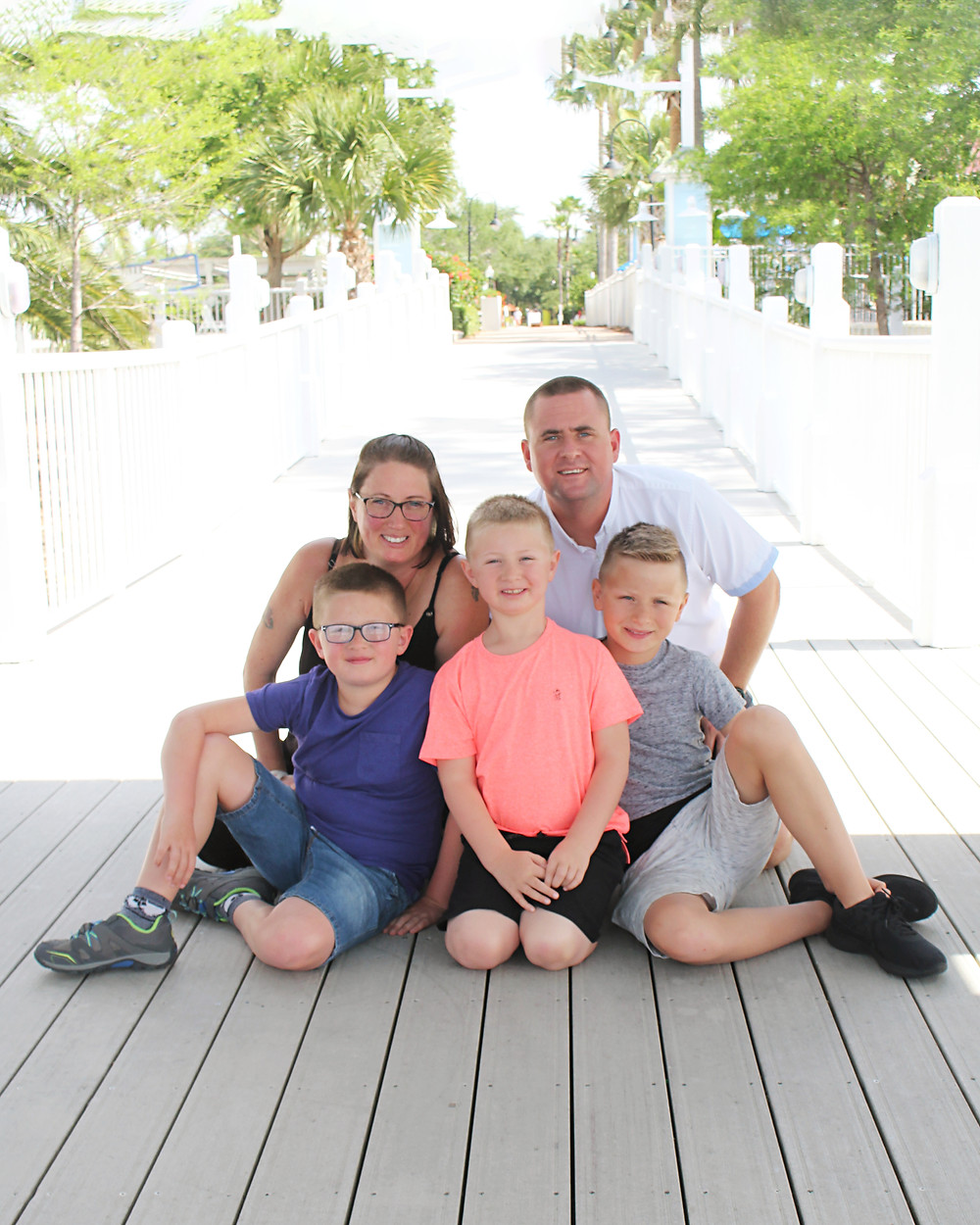 Michelle from Little Feet Photography with husband and her boys