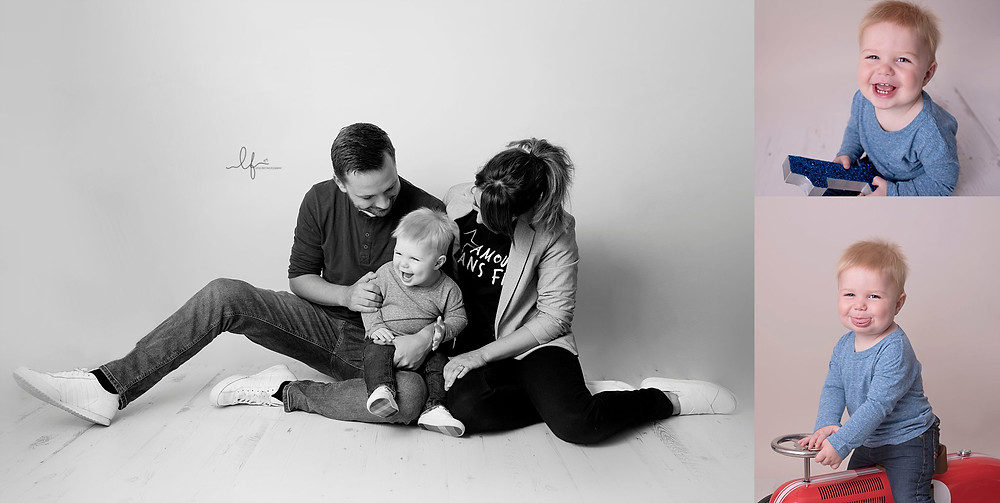 cheeky 12 month old with parents