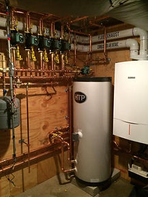 Instillation of a high effiency Bosch boiler with an HTP hot water heater done by S. Ferro Plumbing and Heating
