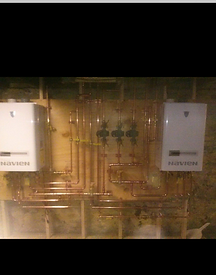 Two wall mounted high efficiency navian boilers with three heating zones installed by S. Ferro plumbing and heating