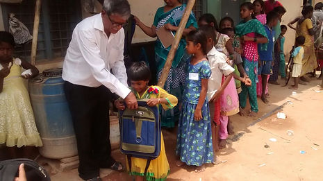 Children wearing new clothes and getting new school bags