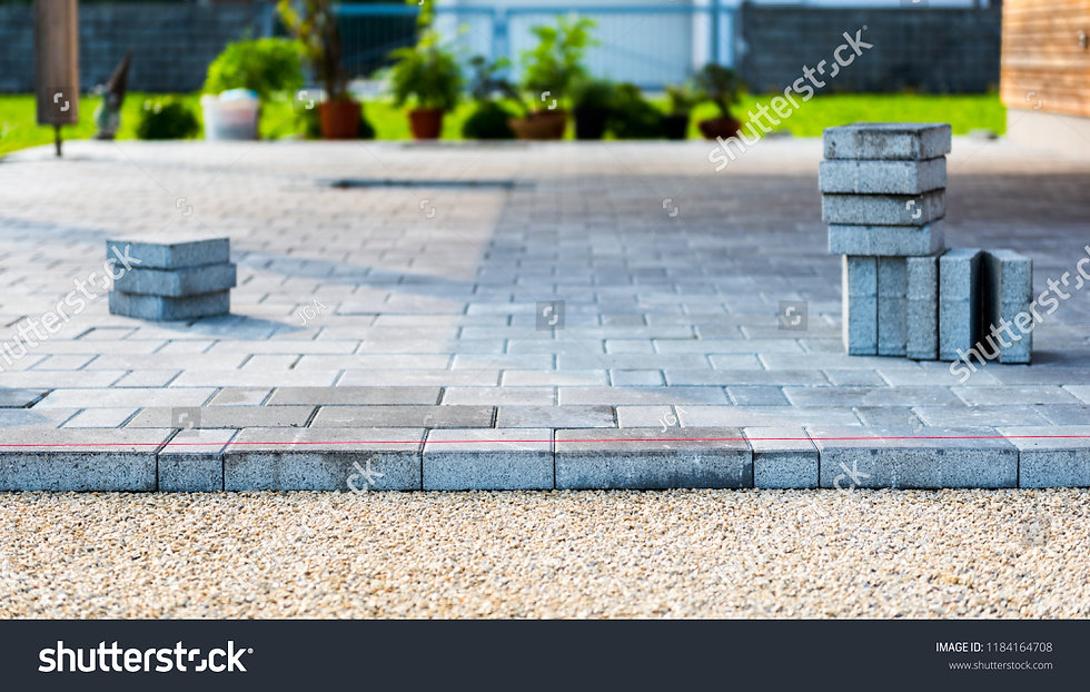 stock-photo-laying-gray-concrete-paving-