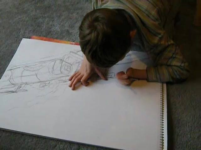 Matthew in 2013, working on A3 size sketch of Lord Nelson steam train. This was submitted as one of his entries to International Naturally Autistic People Awards, Convention & Festival Edinburgh 2014. He was gained top award for Visual Arts - Youth.