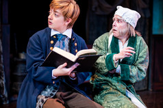 Katrina Dykstra as Boy Scrooge and Carine Montbertrand as Ebenezer Scrooge  A Christmas Carol Titan Theatre Company