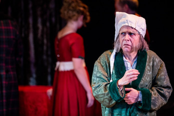 Carine Montbertrand as Ebenezer Scrooge  A Christmas Carol Titan Theatre Company