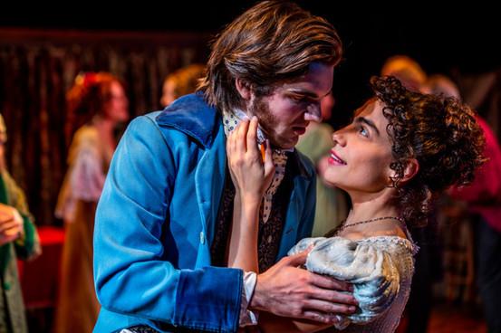 Benjamin Lohrberg as Young Scrooge and Sara Ornelas as Belle  A Christmas Carol Titan Theatre Company