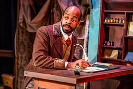 Marcus D. Johnson as Bob Cratchit  A Christmas Carol Titan Theatre Company