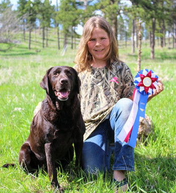 Kate running under a youth handler