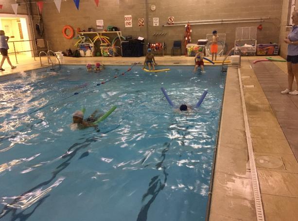Swimmers group practising breaststroke