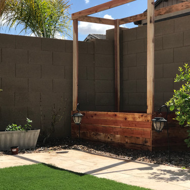 A 2-foot tall garden box with 2x4 posts