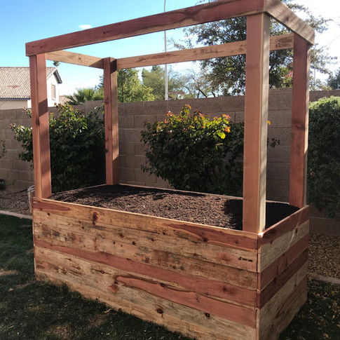 A 2-foot tall garden box with 4x4 posts