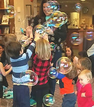 Kids catching bubbles at a children's birthday party