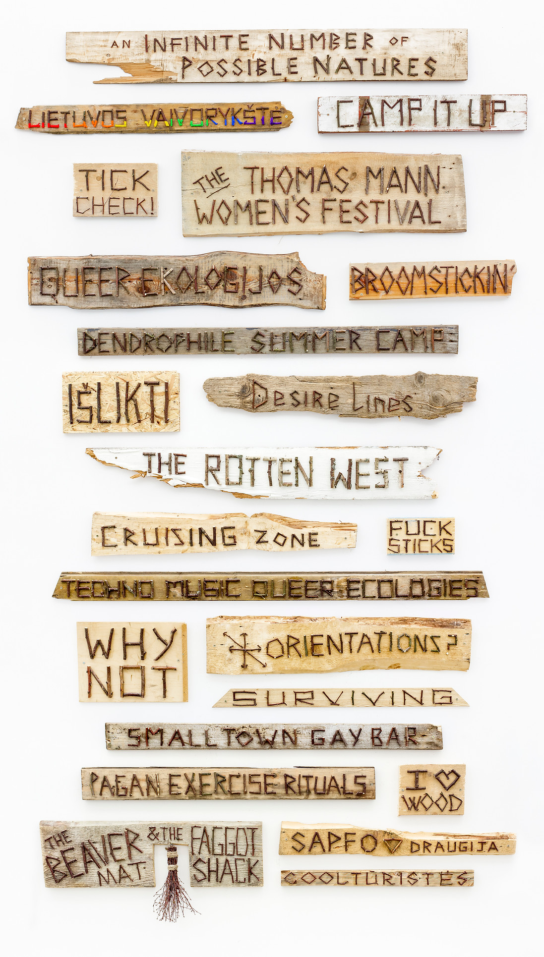 Digital compilation from The Beaver Mat & The Fag(g)ot Shack from 2014 by Hannah & Helen. The image features a series of wooden panels with phrases.