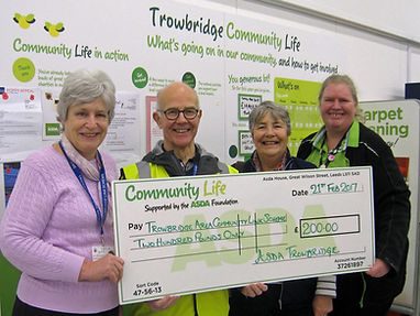 Trowbridge Link volunteers receiving cheque from Asda Green Token scheme