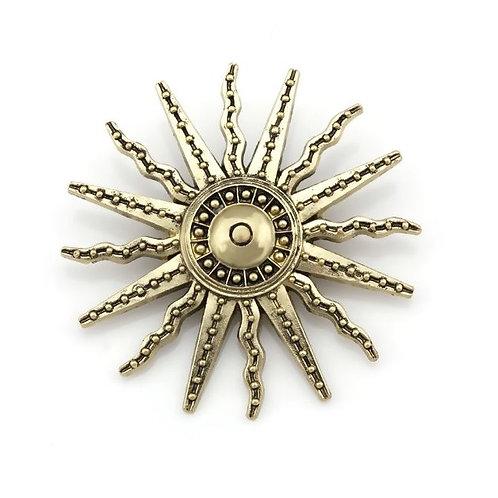 Broche représentant un soleil