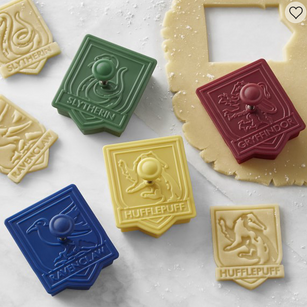 HARRY POTTER™ House Crest Cookie Cutters, Set of 4, Williams Sonoma, $ 16.95  https://www.williams-sonoma.com/products/harry-potter-house-crest-cookie-cutters-set-of-4/?pkey=cbakeware-cookie-shop-cutters&isx=0.0