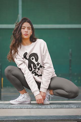 crewneck-sweatshirt-mockup-of-a-woman-crouching-on-a-steel-beam-a19049.png