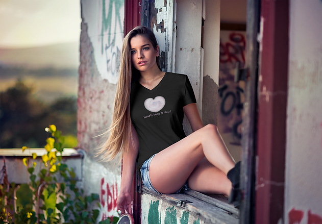 v-neck-tee-mockup-of-a-woman-sitting-on-the-window-of-an-old-building-3681-el1.png